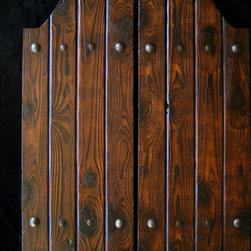 Custom Western Swinging Saloon Doors - Rustic swinging doors handcrafted of reclaimed lumber to your specs. Distressed, aged finish of raised wood grain. Hand forged iron nail head accents. Soft-sheen protective finish.