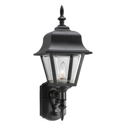 Progress Lighting - Progress Lighting Non-Metallic Incandescent Traditional Outdoor Wall Sconce - This classically designed Progress Lighting outdoor wall sconce from the Non-Metallic Collection is ideal for traditional outdoor lighting schemes. The large finials, torch style body and traditional lantern shape are accentuated by a Textured Black finish. It also features clear beveled glass panels that compliment the traditional flair of the design.