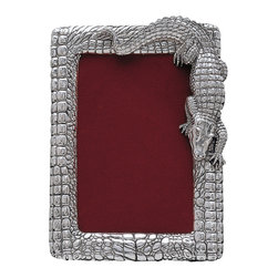 Arthur Court - Alligator Picture Frame - The gator on this silver picture frame isn't just cold-blooded — he's just plain cool! As a gift or whimsical addition to your framed photos at home, this reptilian picture frame won't go unnoticed. Its intricate texture and snappy alligator embellishment make this piece as unforgettable as the memories it will frame.
