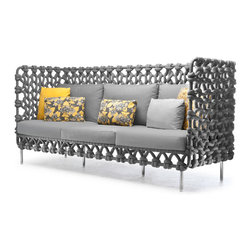 Kenneth Cobonpue High Back Sofa - The Cabaret Collection is inspired by the simplicity and subtle beauty in the art of knitting. Weaving fabric-wrapped foam on a steel frame conveys the next generation of the evolving outdoor luxury furniture market.