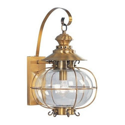 Livex Harbor 2223-22 Outdoor Wall Lantern - 20H in. Flemish Brass - With its large size, the Livex Harbor Outdoor Wall Lantern is an ideal choice for between the garage doors of your seaside home. Nautically inspired with wire trim around a round globe, this light features a Flemish brass finish and hand-blown clear glass. It uses one 150-watt medium-base bulb (not included) and measures 12.75W x 20H inches with a 13.75-inch wall extension.About Livex LightingLivex Lighting is a manufacturer and distributor of decorative residential lighting. The company was founded in 1993 and is now headquartered in a 150,000-square-foot facility in Morristown, New Jersey. Livex Lighting currently offers over 2,500 products ranging from lighting fixtures for indoor and outdoor applications to lampshades, chandelier shades, ceiling medallions, and accent furniture. The goal of Livex Lighting is to provide the highest-quality product at the most affordable price. We are constantly responding to the ever-changing needs, styles, and fashions of the lighting industry while always maintaining the highest standards of quality.