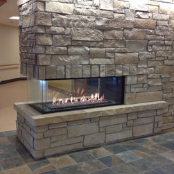 """Cheyenne Regional Medical Center - Custom Three-sided peninsula  fireplace provided by Colorado Custom Fireplace. A 60"""" Montigo PFC520 provides ambience and safety in this public space."""