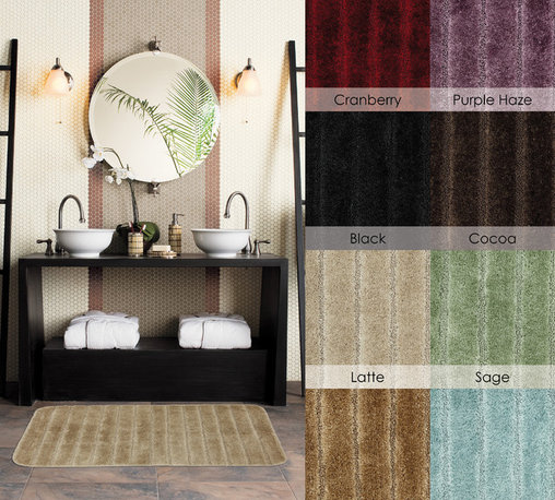 Mohawk Home Bath Rugs - A stylish way to add warmth to your floors, these rugs are available in an array of colors. This rug features a skid-resistant latex back and is machine washable for easy care.
