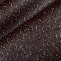 Braid Vinyl Upholstery Fabric in Truffle - Braid Vinyl Upholstery Fabric in Truffle is a brown vinyl with a braided texture pattern that works well for a wide variety of interior design schemes. This classic fabric adds a timeless element to upholstery projects and its durability and ease to clean makes it a top choice for high traffic areas. Made from 100% vinyl. Clean with water based solvent. Width: 54?