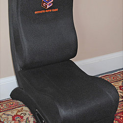 None - Ultimate Reactor Massaging Gaming Chair - Experience video games on a new level with this interactive gaming chair. The contemporary-style chair includes eight game-synced vibrating motors which coordinate with action within video games. The chair is compatible with all major gaming systems.