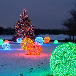 LED Light Balls - Chicago Botanical Gardens - LED light balls adorn the snowy outdoor space at the Chicago Botanical Gardens. LED light balls, which are wrapped using Wintergreen Lighting LED mini lights, are perfect commercial Christmas decorating ideas, as well as weddings and other special events.