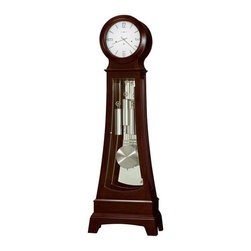 Howard Miller - Gerhard Floor Clock in Chocolate Brown - Chocolate finish on select Hardwoods and Veneers. This fashionable floor clock features a hinged top door with convex Glass, and a hinged Glass bottom door with Nickel knob and hinges. Also features bent Glass on sides. The White dial features applied brushed Nickel Arabic numerals and bar markers, with Nickel finished hour and minute hands. The dial is specially inscribed with an 84th Anniversary Edition inscription (through 2010). Glass mirrored back. Brushed Nickel-finished weight shells and grid pendulum. The multi-tiered base features a distinctive cutout on the front and sides. Illuminated case and dial. Adjustable floor levelers under all four corners level the clock on uneven and carpeted surfaces. Cable-driven, Westminster chime Kieninger movement features an automatic nighttime chime shut-off option. A Howard Miller Heirloom Record Certificate with Nickel-finished capsule is included. Free Nickel Heirloom Nameplate will be engraved with your name and special date. 26 in. W x 13 in. D x 80 1/2 in. H