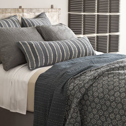 Pine Cone Hill - Pine Cone Hill Resist Floral Grey Kantha Coverlet - Pine Cone Hill home decor, bedding, textiles and sleepwear are synonymous with quality, easy sophistication, vibrant colors and down-to-earth elegance. Striking palettes intersect streamlined patterns on the Graphic Traffic collection, resulting in a bold statement for bedrooms. Inspired by traditional Indian quilts, the Resist Kantha coverlet creates a calm space with soothing prints. The blanket's gray floral design and ornate contrast topstitching pop against a rich, charcoal background. Made from 100% cotton. Hand or machine wash cold and line dry. Available in twin, queen and king sizes. .