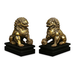 """China Furniture and Arts - Hand Forged Iron Foo Dogs - In Chinese mythology, Foo Dogs are fantasy lions who serve as guardians to prevent harmful things from happening to the family. Always standing in pairs, these figures are depicted in commanding posture. The male, with a paw on a symbolic ball, protects the world, while the female, with a paw on a cub, protects the dwelling. This handsome pair is hand forged in iron by artisans in China with fine detail. Each one is 10.75""""W x 6.5""""D x 13.75""""H. Wooden stands included."""