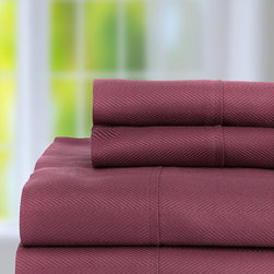 Castle Hill, London - Purple 600-TC Egyptian Cotton Jacquard Herringbone Sheet Set - This set surrounds you with the luxurious touch of silky, soft Egyptian cotton and gives your bedroom the look and feel of pure decadence. �� Includes flat sheet, fitted sheet and two pillowcases Fits mattresses up to 18'' 100% Egyptian cotton 600-thread count Machine wash Imported