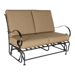 O.W. Lee Classico Wrought Iron Loveseat Glider - Enjoy spending time outdoors throughout the summer while gently gliding and relaxing with the O.W. Lee Classico Loveseat Glider. Wonderfully made from handcrafted wrought iron, this loveseat glider features a classic basket weave design and rich, Old World craftsmanship. A gorgeous addition to your patio, porch, or deck, the Loveseat Glider is perfect for intimate conversations with friends and family while you enjoy the peacefulness of the outdoors. The Loveseat Glider comes with a Sunbrella cushion available in your choice of color so you can accent the natural colors of your backyard and complement your existing decor. Sunbrella cushions are fade-, stain-, mildew-, and water-resistant and come with a five year warranty. You'll enjoy sneaking outdoors in the early morning to enjoy your first cup of coffee alone, or spending time with your children watching the stars come out. Wherever you place this loveseat glider, it invites you to enjoy time with loved ones or relaxing and letting the stress of the day go.Please note: This piece will be delivered with White Glove service which includes location placement. Unpacking and assembling the item will be left to the customer. Due to the custom-made nature of this item, orders usually ship within approximately 5 weeks. Because each item is assembled just for you, orders cannot be cancelled. A 50% restocking fee will apply for returns.This item is custom-made to order, which means production begins immediately upon receipt of each order. Because of this, cancellations must be made via telephone to 1-800-351-5699 within 24 hours of order placement. Emails are currently not acceptable forms of cancellation. Thank you in advance for your consideration in this matter.Materials and construction:Only the highest quality materials are used in the production of O.W. Lee Company's furniture. Carbon steel, galvanized steel, and 6061 alloy aluminum is meticulously chosen for superior strength as well as rust and corrosion resistance. All materials are individually measured and precision cut to ensure a smooth, and accurate fit. Steel and aluminum pieces are bent into perfect shapes, then hand-forged with a hammer and anvil, a process unchanged since blacksmiths in the middle ages.For the optimum strength of each piece, a full-circumference weld is applied wherever metal components intersect. This type of weld works to eliminate the possibility of moisture making its way into tube interiors or in a crevasse. The full-circumference weld guards against rust and corrosion. Finally, all welds are ground and sanded to create a seamless transition from one component to another.Each frame is blasted with tiny steel particles to remove dirt and oil from the manufacturing process, which is then followed by a 5-step wash and chemical treatment, resulting in the best possible surface for the final finish. A hand-applied zinc-rich epoxy primer is used to create a protective undercoat against oxidation. This prohibits rust from spreading and helps protect the final finish. Finally, a durable polyurethane top coating is hand-applied, and oven-cured to ensure a long lasting finish.About SunbrellaSunbrella has been the leader in performance fabrics for over 45 years. Impeccable quality, sophisticated styling and best-in-class warranties prove the new generation of Sunbrella offers more possibilities than ever. Sunbrella fabrics are breathable and water-repellant. If kept dry, they will not support the growth of mildew as natural fibers will. Beautiful and durable, Sunbrella is a name you can trust in your outdoor furniture.About O.W. Lee CompanyAn American family tradition, O.W. Lee Company has been dedicated to the design and production of fine, handcrafted casual furniture for over 60 years. From their manufacturing facility in Ontario, California, the O.W. Lee artisans combine centuries-old techniques with state-of-the-art equipment to produce beautiful casual furniture. What started in 1947 as a wrought-iron gate manufacturer for the luxurious estates of Southern California has evolved, three generations later, into a well-known and reputable manufacturer in the ever-growing casual furniture industry.