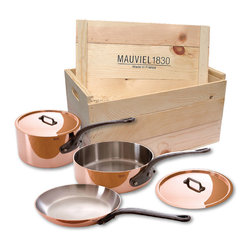 Mauvel M'Heritage 150c 5 Piece Copper Cookware Set W/ Wooden Crate - The Mauviel M'Heritage 5 piece cookware set allows you to cook with unsurpassed heat conductivity and control thanks to it̥s 90% copper  10% stainless steel construction.  The M̥150c collection features classic cast iron handles  stainless rivets  a polished copper exterior  and an 18/10 stainless interior.  The cookware has a thickness of 1.5 mm  and the copper exterior allows for superior heat conduction and control.  The M'Heritage collection represents the total experience and heritage of Mauviel 1830.  This set comes packaged in a traditional and attractive wood crate  a great touch for gift presentation.  Set includes      1.9 qt Saucepan (6410.17)   1.9 qt Saucepan Lid   3.2 qt Saut�_ Pan (6411.25)   3.2 qt Saut�_ Pan Lid   10.2 in Frypan     Product Features      Bilaminated copper stainless steel - 90% copper and 10% 18/10 stainless steel   Copper cookware heats more evenly and much faster than other metals  and offers superior cooking control   1.5 mm thickness   18/10 stainless steel interior preserves the taste and nutritional qualities of foods and is easy to clean   Mauviel M'150c cookware can be used on gas  electric  halogen stovetops  and in the oven. It can also be used on induction stovetops with Mauviel's induction stove top interface disc (sold separately)   Mauviel cookware is guaranteed for life against any manufacturing defects (Warranty not valid for commercial use)   Made in France