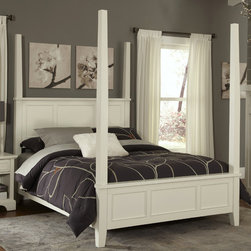 "Home Styles - Naples Four Poster Bed - Unadorned details such as the straight and curved lines and slightly flared legs create the contemporary style of the Naples Poster Bed. Features: -Slightly flared legs.-Contemporary style.-Includes raised panels on the headboard and footboard.-Hardwood solids and engineered wood construction.-White finish.-Naples collection.-Powder Coated Finish: No.-Gloss Finish: No.-Finish: White.-Frame Material: Hardwood solids and engineered wood.-Upholstered: No.-Non Toxic: Yes.-Scratch Resistant: No.-Mattress Included: No.-Box Spring Required: Yes -Boxspring Included: No..-Headboard Storage: No.-Footboard Storage: No.-Underbed Storage: No.-Slats Required: Yes -Number of Slats Required: 3.-Slats Included: Yes..-Center Support Legs: Yes.-Distressed: No.-Bed Rails Included: Yes.-Collection: Naples.-Eco-Friendly: Yes.-Recycled Content: No.-Jewelry Compartment: No.-Swatch Available: No.-Commercial Use: No.-Product Care: Clean with damp cloth.Specifications: -FSC Certified: Yes.-EPP Compliant: No.-CPSIA or CPSC Compliant: Yes.-CARB Compliant: Yes.-ISTA 3A Certified: Yes.Dimensions: -Overall Height - Top to Bottom (Size: Queen, King): 60.25"".-Overall Width - Side to Side (Size: Queen): 56.5"".-Overall Width - Side to Side (Size: King): 72.5"".-Overall Depth - Front to Back (Size: Queen, King): 88"".-Overall Product Weight (Size: Queen): 151 lbs.-Overall Product Weight (Size: King): 169 lbs.-Headboard Dimensions Height (Size: Queen, King): 22.75"".-Headboard Width Side to Side (Size: Queen): 56.5"".-Headboard Width Side to Side (Size: King): 72.5"".-Headboard Depth Front to Back (Size: Queen, King): 2.5"".-Shelving: No.-Drawer: No.-Cabinet: No.-Footboard Height (Size: Queen, King): 13.25"".-Footboard Width - Side to Side (Size: Queen): 56.5"".-Footboard Width - Side to Side (Size: King): 72.5"".-Footboard Depth - Front to Back (Size: Queen, King): 2.5"".-Trundle Bed: No.-Side Rail Length: 82"".Assembly: -Assembly Required: Yes.-Tools Needed: Phillips screwdriver.-Additional Parts Required: No.Warranty: -Product Warranty: Vendor replaces parts for 30 days."