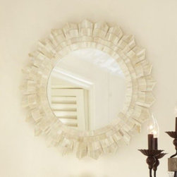 Bone Sunburst Mirror - I'm a bit over some of the retro sunburst mirrors, but this handmade round bone sunburst mirror is more subtle and has a bit of elegant coastal flair to it. The light iridescent bone material reflects the light almost as well as the mirror does.