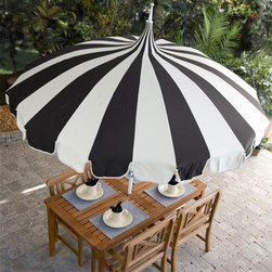 Pagoda 8-1/2-foot Patio Umbrella by California Umbrella - Any fans of Audrey Hepburn's My Fair Lady will recognize the silhouette of this gorgeous outdoor umbrella and the inward-tapering stripes from the film's uber-upper-crust horse racing scene. Elements that inspire daydreams about vintage films are super appealing in decor, particularly for the outdoors.
