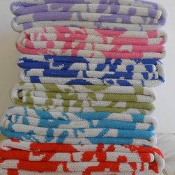 "Cheeky tenango throw - 80% recycled cotton/ 20% acrylic 50""w x 60"" l heavy jacquard knit throw. Yarn dyed. Interpretation of an Otomi tenango/ Mexican weaving. Made in U.S."