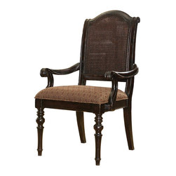 Frontgate - Isla Green Arm Chair - Frontgate - Dark, heavily distressed Tamarind finish accentuates the richly carved legs and scroll accents on the back and arms. Tight seat with rich tapestry-patterned upholstery. Assembly required. Coordinates with other items from our Tommy Bahama Kingstown collection. With classic British Colonial styling, our Isla Verde Arm Chair brings a touch of the exotic to the familiar. An open-caned back, intriguing dark finish and tapestry-patterned upholstery, infused with spice tones, are layered over a traditional silhouette and ornately turned legs - creating a versatile design that can play elegant or relaxed.  .  .  .  .