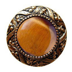 "Inviting Home - Victorian Knob (24K gold plate with tiger eye) - Victorian Knob in 24K gold plate with tiger eye semi-precious stone 1-3/8"" diameter Product Specification: Made in the USA. Fine-art foundry hand-pours and hand finished hardware knobs and pulls using Old World methods. Lifetime guaranteed against flaws in craftsmanship. Exceptional clarity of details and depth of relief. All knobs and pulls are hand cast from solid fine pewter or solid bronze. The term antique refers to special methods of treating metal so there is contrast between relief and recessed areas. Knobs and Pulls are lacquered to protect the finish. Alternate finished are available. Tiger Eye semi-precious stone is chalcedonies quartz with a very silky luster that changes with the different light that hits it. Some Tiger Eye stones contain different color strips. It is a common belief that if you hold tiger eye stone it helps your overall spiritual well-being and health. It is a traditional gift for a 9th wedding anniversary. Victorian Jewel pulls and knobs will allow you to have so much fun with the design. The pulls and knobs come in five different kinds of semi-precious stones: Black Onyx Tiger Eye Blue Sodalite Red Carnelian and Green Aventurine. You can even use all of the different colors of the semi-precious stones on one cabinet fa�ade�which would give it an eclectic and playful look."