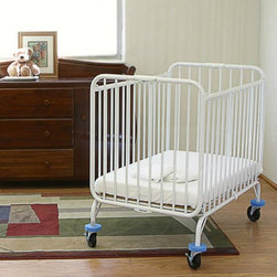 LA Baby - LA Baby Compact Metal Folding Crib with 3 in. Mattress - CS882 - Shop for Cribs from Hayneedle.com! While you're spending your day worrying about juice boxes and wondering exactly where that one kid's other shoe is you can take a little comfort knowing that the LA Baby Compact Metal Folding Crib with 3 in. Mattress is strong safe and exactly where you need it. The rugged metal frame of this folding crib is powder-coated and non-toxic so cleaning is safe and easy. Heavy-duty casters on each leg have foam bumpers to protect your furniture and once it's in place the casters can be securely locked. When the day is done this metal crib can be folded up and stored conveniently out of the way. The legs are reinforced with the gaps of elevators in mind in the event that an emergency arises and you need to get the crib moved quickly. The included mattress is fire-retardant in compliance with Federal Flammability Standards.About LA BabyL.A. Baby is an award-winning division of Amwan a manufacturer and distributor of fine quality juvenile furniture. With products designed for residential and commercial use L.A. Baby items can be found in homes day cares and hotels. Based in City of Industry California L.A. Baby offers a wide range of baby items including cribs strollers safety gates changing pads and high chairs.