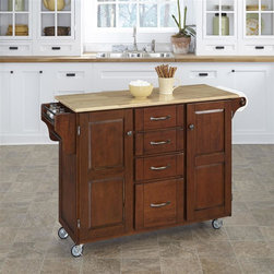 HomeStyles - Kitchen Cart in Cherry Finish - Natural wood top. Four easy open drawers. Two large cabinets and outdoor compartments. Sleek, stylish and sophisticated wood top. Condiment rack with a towel bar. Other end features a paper towel holder. Consists four heavy duty locking rubber casters for easy mobility and safety. Clear coat finish helping to protect against wear from normal use. Made from wood and veneer. 48 in. L x 17.75 in. W x 35.5 in. H. Top Assembly InstructionHome Styles' Creat-a-Cart is a unique and refreshing solution for kitchen utility. Enjoy unique and refreshing solution for kitchen utility