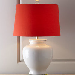 "Horchow - White Table Lamp with Orange Silk Shade - A cheery orange silk shade tops a squat porcelain table lamp perched on a disk of clear acrylic. Uses one 100-watt bulb. 17""Dia. x 29""T. Imported."