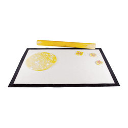 Paderno World Cuisine - Nonstick 25.37-by-17-1/2-in. Pastry Mat - This unique mat is composed of fiberglass and is coated on both sides with non stick silicone, allowing for the dough to be rolled out effortlessly. The World Cuisine silicone ski-resistant counter pastry mat is ideal for kneading, beating and rolling dough or working with sugar and chocolate. This mat can withstand extreme temperature ranges, however it is not designed to be a baking mat and should never be folded or cut in order to fit in a conventional oven.