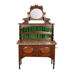Antiques - Dark Walnut Victorian Washstand Vanity W/ Marble & Tiles - This is a beautiful antique English Victorian washstand vanity with marble top and tiles. It features a beautiful beveled oval mirror which tilts for your convenience and it is held by a beautiful carved frame with foliage and scroll decorations with two gorgeous supports also carved with floral decorations. It has a beautiful marble top surface which though it has minor age appropriate imperfections which are barely visible, mostly by touch, it is in very good condition considering its age, circa 1890, and it has a distinguished backsplash with attractive green tiles and pierced sides. This washstand has a spacious cabinet and its two doors are decorated with lovely oval raised paneled surfaces and they have attractive brass handles. On one side it has two metal rod holders should you wish to add a rod for holding towels and it has turned feet with convenient casters. This piece may show some age appropriate wear and tiny white spots which may be removable otherwise it is overall in very good cosmetic and structural condition and it is strong and sturdy. It is a lovely piece suitable with many interiors. Other Dimensions (In inches)Mirror 11.5H x 13.5WTop Surface 29.25H x 42.25W x 17.25DCabinet 12.5H x 36.5W x 15.75D