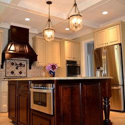 Distressed Ivory Kitchen Accented by Walnut Island & Range Hood - Christopher Donati