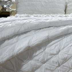 Cottage Home - Aiden 3-piece Quilt Set - This luxurious solid white quilted bedding collection is exactly what is needed for an inspirational palette creating a unique style. The cotton quilt set comes in brilliant white and is machine washable.