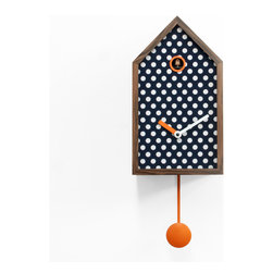 Progetti - Mr. Orange Polka Dots Wall Clock - Wall cuckoo clock with the classical form, already known and appreciated, to which we are attached: the cottage. Here, however, the lines are clean, simple, the structure is reduced to the essence. Mr. Orange is realized by a solid walnut grid with reduced section that defines a number of areas filled with different patterns. As a painting, the structure acts as a frame. You can choose between different textures to give the preferred form to Mr. Orange and match the style of your home. In addition to the wooden frame, the common feature that distinguishes every clock is the orange color. Battery quartz movement. The Cuckoo strike is switched off automatically during the night controlled by a light sensor.