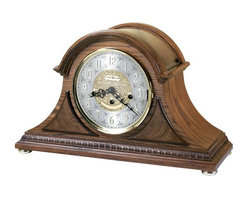 HOWARD MILLER - Barrett II Key Wound Mantel Clock with Keywound, Westminster Chime Movement - This tambour mantel clock features decorative egg-and-dart molding that wraps around the base, and rare olive ash burl overlays accenting the front.
