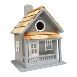 "Home Bazaar - Little Cabin Birdhouse - Blue - The Little Cabin Birdhouse in Colonial Blue is just like the cabin you'd hike to in the mountains. Just picture yourself resting your weary feet on the porch railing! Constructed of exterior grade ply-board, Pine roof shingles and poly resin for detail and decorations. The swing-up mounting peg makes installation a snap. Fully equipped with: 1 1/4"" opening, removable back wall, drainage, ventilation and an unpainted interior. Item Dimensions: 8 1/2"" H x 7"" W x 5 1/2"" D."
