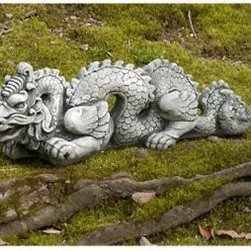 Small Dragon Garden Statue - You'll love the elegantly carved scales, the highly detailed snout, and flowing form and shape of the Small Dragon Garden Statue. This smiling dragon was artisan produced in cast stone and features a hand applied finish. To help blend the Small Dragon statue with your home's garden we have a variety of finishes available.Add a little Asian influence to your home's garden with the beautifully sculpted cast stone Small Dragon garden statue.About Campania InternationalEstablished in 1984, Campania International's reputation has been built on quality original products and service. Originally selling terra cotta planters, Campania soon began to research and develop the design and manufacture of cast stone garden planters and ornaments. Campania is also an importer and wholesaler of garden products, including polyethylene, terra cotta, glazed pottery, cast iron, and fiberglass planters as well as classic garden structures, fountains, and cast resin statuary.Campania Cast Stone: The ProcessThe creation of Campania's cast stone pieces begins and ends by hand. From the creation of an original design, making of a mold, pouring the cast stone, application of the patina to the final packing of an order, the process is both technical and artistic. As many as 30 pairs of hands are involved in the creation of each Campania piece in a labor intensive 15 step process.The process begins either with the creation of an original copyrighted design by Campania's artisans or an antique original. Antique originals will often require some restoration work, which is also done in-house by expert craftsmen. Campania's mold making department will then begin a multi-step process to create a production mold which will properly replicate the detail and texture of the original piece. Depending on its size and complexity, a mold can take as long as three months to complete. Campania creates in excess of 700 molds per year.After a mold is completed, it is moved to the production area where a team individually hand pours the liquid cast stone mixture into the mold and employs special techniques to remove air bubbles. Campania carefully monitors the PSI of every piece. PSI (pounds per square inch) measures the strength of every piece to ensure durability. The PSI of Campania pieces is currently engineered at approximately 7500 for optimum strength. Each piece is air-dried and then de-molded by hand. After an internal quality check, pieces are sent to a finishing department where seams are ground and any air holes caused by the pouring process are filled and smoothed. Pieces are then placed on a pallet for stocking in the warehouse.All Campania pieces are produced and stocked in natural cast stone. When a customer's order is placed, pieces are pulled and unless a piece is requested in natural cast stone, it is finished in a unique patinas. All patinas are applied by hand in a multi-step process; some patinas require three separate color applications. A finisher's skill in applying the patina and wiping away any excess to highlight detail requires not only technical skill, but also true artistic sensibility. Every Campania piece becomes a unique and original work of garden art as a result.After the patina is dry, the piece is then quality inspected. All pieces of a customer's order are batched and checked for completeness. A two-person packing team will then pack the order by hand into gaylord boxes on pallets. The packing material used is excelsior, a natural wood product that has no chemical additives and may be recycled as display material, repacking customer orders, mulch,or even bedding for animals. This exhaustive process ensures that Campania will remain a popular and beloved choice when it comes to garden decor.Please note this product does not ship to Pennsylvania.