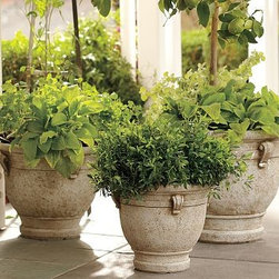 """Brittany Cast-Stone Planter, Medium - Artfully cast, our planters have been mottled and treated with a special pigment to mimic weathered limestone. Ornamental handle detailing. Small: 14.5"""" diameter, 12.5"""" high; 10 lbs Medium: 18"""" diameter, 14.5"""" high; 15.5 llbs Large: 21.5"""" diameter, 18"""" high; 22 lbs Made of re-constituted cement."""