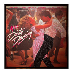 """Glittered More Dirty Dancing Album - Glittered record album. Album is framed in a black 12x12"""" square frame with front and back cover and clips holding the record in place on the back. Album covers are original vintage covers."""