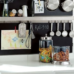 "Stainless-Steel Utility Shelf with Hooks, 4 x 36"" - Maximize your kitchen and office workspace with the versatile beauty - and durability - of stainless-steel accessories. Backsplash includes 5 clothespin magnets; multiples can be installed to line the entire kitchen. Magnetic canisters for storing spices attach to the backsplash. Post recipes, postcards or photos on the square and long rectangular boards. Alphabet magnets include all 26 letters. Ultra-thin gallery ledge can be used as a spice rack by adding our set of 6 flat-sided glass jars with airtight lids (sold separately). Mounting hardware included. Catalog / Internet Only."