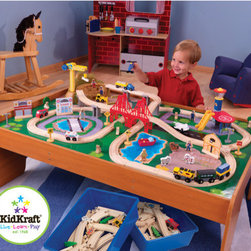 KidKraft - Ride Around Town Train Set with Table - With the exciting Ride Around Town Train Set with Table, the young conductors in your life have an entire busy community at their fingertips! The train set will provide kids with hours of imaginative play while the table helps keep playtime off the floor and closer to eye level. Features: -Includes one hundred colorful train pieces, buildings and accessories, moveable crane, airport with runway and helipad and hospital with ambulance -Two bins for convenient storage -Large enough to accommodate multiple playing children -Made of wood -compatible with Thomas and Friends wooden train sets and Brio wooden train sets -Other Imagination Express toys from KidKraft available separately