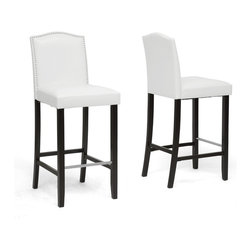 Wholesale Interiors - Libra White Modern Bar Stools with Nail Head Trim, Set of 2 - The look of nailhead-studded faux leather pairs beautifully with a contemporary update in the lust-worthy Libra Designer Bar Stool. The simple silhouette of this contemporary bar stool is made in Malaysia with a solid rubber wood frame, foam cushioning, iron spring supports, and a stainless steel foot rest. White faux leather pairs with a black frame and non-marking feet for the win. To clean, wipe with a damp cloth. The Libra Stool requires assembly and a rubber mallet. Brown and Black faux leather options are also available (sold separately).