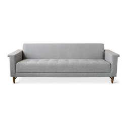 Gus* - Harbord Sofa - Harbord Sofa  by Gus Modern    At A Glance:   The Harbord Loft Bisectional Sofa is one of the most decked-out sofas in Gus Modern's lineup, with mid-century inspired features ranging from the tapered, solid wood legs with stringer accents to the thick, tufted seat cushions. Flanged arms provide handy armrests - or bookrests.   What's To Like:  The style of this three-seat sofa is at once classic and modern. It's really helped along by the stunning flanged arms that define the piece.If you want to anchor the look of your living space, you'll love this sofa. It's a solid, stylish piece that has a distinct presence.Live big with a smaller footprint - this medium size sofa is great for in-between sized living spaces.  What's Not to Like:   With all its accents and thick tufted upholstery, the Harbord Sofa ends up costing a pretty penny.  The Bottom Line:   The Harbord Sofa from Gus Modern is, notwithstandi