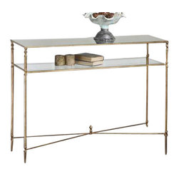Uttermost Henzler Mirrored Glass Console Table - Antiqued gold leaf, forged iron with iron cross stretchers. Top is reinforced mirror and gallery shelf is clear tempered glass. Forged iron frame and iron cross stretchers in antiqued gold leaf. Top is reinforced mirror and gallery shelf is clear tempered glass.