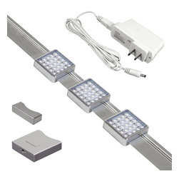 "Jesco - LED Orionis 3' Under Cabinet Track Light Kit - This state of the art under cabinet LED unit has a customizable system that allows you to position the 3 square LED modules wherever you like along the track. This slender silver finish design provides excellent light output in a warm white color temperature. By placing units closer together to create overlapping beams with increased foot candles. From Jesco Lighting. Customizable under cabinet track light kit. 3 LED modules slide to position where you want them. Dimmable. 54 lumens per kit; warm white 3000K color temperature. Uses 6 watts of energy. 59"" long white power cord. Includes on/off switch 2 end caps plug and play driver and 2 mounting clips. 5-year warranty. Track is 23 3/4"" wide 1 3/4"" deep and 3/4"" high. LED modules are 2 1/4"" square and 3/4"" high.  Customizable under cabinet track light kit.  3 LED modules slide to position where you want them.  Dimmable.  54 lumens per kit; warm white 3000K color temperature.  Uses 6 watts of energy.  59"" long white power cord.  Includes on/off switch 2 end caps plug and play driver and 2 mounting clips.  5-year warranty.  Track is 23 3/4"" wide 1 3/4"" deep and 3/4"" high.  LED modules are 2 1/4"" square and 3/4"" high."