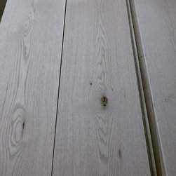 Live Sawn / French Cut White Oak Flooring - Manufacturing Photo of Live Sawn White Oak plank flooring. This lumber was cut in the same style as French Cut. It has traditional cathedrals through the center of the plank with tight Rift & Quarter Sawn along the edges.