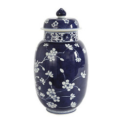 Blue and White Porcelain Vase, Lidded - Ginger jars are the classic way to pop some blue and white into your space. I love that this one is mostly a deep navy. It's such a pretty choice.