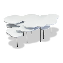 STUDIO COPENHAGEN - Clouds White Coffee Table Set - If you're a little bit of a purist and don't want to spend big bucks on modern design, this cloud coffee table is under $350 and delivers that unique look for a modern space.