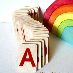 Raised Felt Alphabet On Wood Uppercase Set with Acorn Pouch by Wee Waldorf - These wooden alphabet cards feature a raised red felt letter, so your child can feel each one too. Babies love texture, so I'm sure this alphabet set would be a hit.