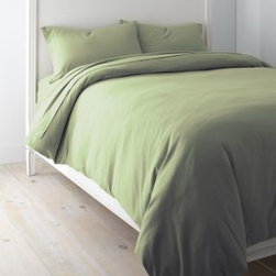 Garnet Hill - Garnet Hill Solid Jersey-Knit Crib Fitted Sheet - Crib - Fitted - Olive Leaf - This cozy combed-cotton jersey-knit bedding is knit of fine yarns for softness, and has a tighter construction than most for a smoother, more substantial feel. Dress your bed with the casual style and comfort of a favorite T-shirt. This higher-quality knit bedding looks great wash after wash, and won't twist on the mattress. A great year-round sheet. Clean double-stitched finish. Fitted sheet is fully elasticized for a better fit. 12-inch pocket depth.