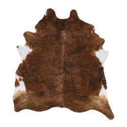 Koldby Cowhide, Brown/White - A cowhide is unexpected in a dining space. It hides stains surprisingly well, and its asymmetrical shape breaks up the lines of the table and chairs.