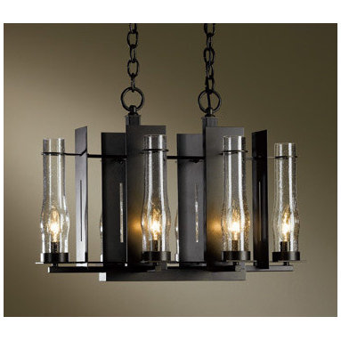 New Town 6-light Chandelier by Hubbardton Forge - New Town 6-light Chandelier is available in a seeded clear glass with the choice of dark smoke, burnished steel, natural iron, bronze, black, or mahogany finishes. Six 40-watt, 120 volt B10 candelabra base incandescent bulbs are required, but not included. Dimensions: 14.2W x 15.4H.