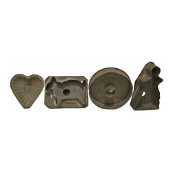 Cookie Cutters Set - A vintage collection of four (4) tin cookie cutters in assorted patterns.