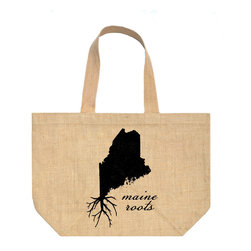 "Fiber and Water - Maine Roots Tote Bag - A great silhouette of the state of Maine, enhanced with roots for those Maine natives who are never too far away.  Great for the farmers market, going to the beach, or shopping around town. Strong enough to hold all of your purchases.  Hand pressed water-based ink, black. 100% Natural Burlap, Linen lining 20""w x 14""h x 6""d. Printed in Maine."